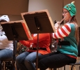 Melissa McIntyre plays flute in the University Wind Ensemble Fantasy of Lights concert Nov. 21. Photo by Topher McGehee