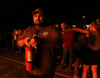 Mario Ramirez, interim director of student involvement, at the homecoming bonfire Oct. 19, 2017. Photo by Bradley Wilson
