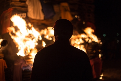 Head football coach Bill Maskill lights the bonfire on Oct. 27. Photo by Izziel Latour