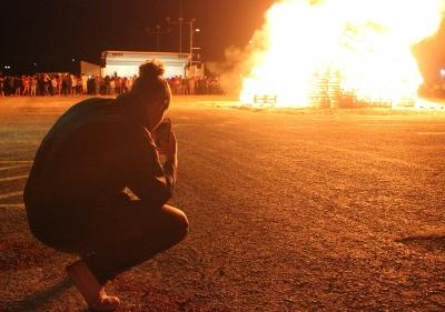 Cameron O'Neal, pre-med sophomore, gets a picture of the Homecoming Bonfire Thursday, Oct. 19, 2017. Photo by Rachel Johnson