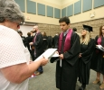Michael Pesquieda, sports and leisure, waits in line, to be given instructions on where to stand with his department, while waiting for Commencement to begin, May 14. Photo by Rachel Johnson