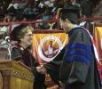 University President Suzanne Shipley contratulates Hardin Professor, Jianguo Shao, an associate professor of chemistry.