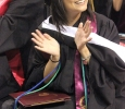 Andrea Moreno, clinical psychology, claps for her familyat the end of Commencement, held ing Kay Yeager Coliseum, May 14. Photo by Rachel Johnson