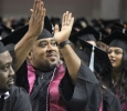 Brandon Torres, BAAS, claps for his family, friends, and supporters at the end of Commencement, held ing kAy YEager Coliseum, May 14. Photo by Rachel Johnson