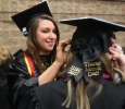 Emma Davenport Respiratory Care graduate helps fellow Respiratory Care graduate put on graduation cap.Midwestern State University Commencement Cermemony, Kay Yeager Coliseum.May 14th.by Timothy Jones