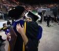 Yvette Ordonez hugs Jim Sernoe, mass communication associate professor, at Midwestern State University graduation, May 13, 2017. Photo by Bradley Wilson