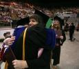 Megan Piehler hugs mass communication associate professor Jim Sernoe at Midwestern State University graduation, May 13, 2017. Photo by Bradley Wilson