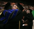 A theater student hugs Karen Dabney while Houston Pokorney hugs Christie Maturo at Midwestern State University graduation, May 13, 2017. Photo by Bradley Wilson