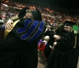 Theater students hug instructors at Midwestern State University graduation, May 13, 2017. Photo by Bradley Wilson