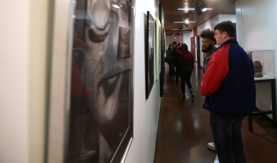 Rozarious Bell, a senior at Sabine High School, and Jacob Keifer, also a senior at Sabine High School, look at artwork before the opening of the MWSU High School Art Show, Feb. 3, 2018. Photo by Treston Lacy