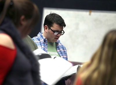 Home-school senior Steven Kintner reads his libretto during a music rehearsal on Thursday, Jan. 25, 2018.
