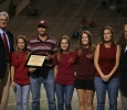 Associate Professor of Chemistry Chris Hansen receives his recognition as the Annual Letterman's Award from the student athletes at the homecoming game, Oct. 25, 2015. Photo by Bradley Wilson