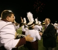 University President Jesse Rogers thanks band members after halftime during which the band played a series of songs recognizing Rogers who is retiring at the end of the year at the homecoming game, Oct. 25, 2015. Photo by Bradley Wilson