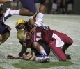 Quade Coward, exercise physiology sophomore, is sacked in the game between Midwestern State University and Texas A&M-Commerce, Saturday, Oct. 25, 2014 at Memorial Stadium. Photo by Lauren Roberts
