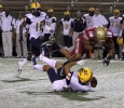 Ricardo Riascos, criminal justice senior, hits Commerce's freshman wide-reciever Shawn Hooks as he tries to catch a punt in the game between Midwestern State University and Texas A&M-Commerce, Saturday, Oct. 25, 2014 at Memorial Stadium. Photo by Lauren Roberts