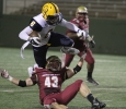 Adam Hill, history sophomre, tackles Commerce's Vernon Johnson, senior wide reciever, in the game between Midwestern State University and Texas A&M-Commerce, Saturday, Oct. 25, 2014 at Memorial Stadium. Photo by Lauren Roberts