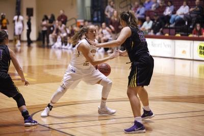 Liz Cathcart, marketing sophomore, fakes out Rayan Starnes, Hardin-Simmons player, during the MSU vs Hardin-Simmons game in D.L. Ligon Coliseum where MSU won 61-42, Thursday, Nov. 2, 2017. Photo by Francisco Martinez