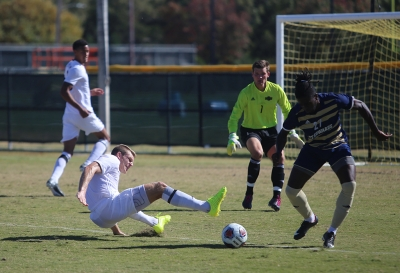 Alex Mullett goes down while trying to take a ball during the Heartland Conference championship game aginst St. Edward's University. MSU won 1-0. Photo by Bradley Wilson