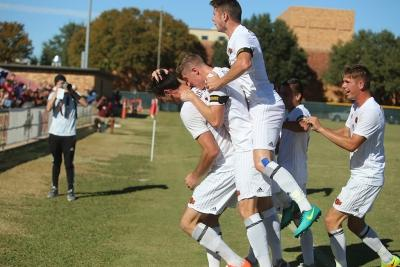 Players react after Scott Doney scored the first and only goal during the Heartland Conference championship game aginst St. Edward's University. MSU won 1-0. Photo by Bradley Wilson