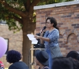 Claudia Montoya, associate professor of spanish, tells stories of hateful encounters to the audience for the Resist Hate Rally held in Sunwatcher Plaza on Sept. 1. Photo by Marissa Daley