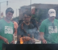 Jonathan Blassingame, radiology sophomore, Ben Edfeldt, director of the Baptist Student Ministry, and John Gill cook hamburgers. Photo by Bradley Wilson