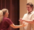 Tessa Rae Dschaak, theatre sophomore, acting with Jonathan Stone, theatre junior, with tea as a metaphor as a positive consent response at the Since Last Night performed by the theatre in Akin Auditorium on Aug 25th. Photo by Kayla White.