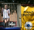 """Morgan White, psychology sophomore, sits on the dunking booth during Roundup Olympics on the Quad Aug. 24. """"The water wasn't cold,"""" she said. """"It feels uncomfortable being in the water in front of everybody."""" Photo by Bradley Wilson"""