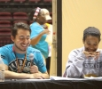 Tim Torres, chemistry junior, and Tionne Fuller, social work junior, as news anchors at News You Can Use preseted by the peer councellors on Aug 22nd in the D.L Ligon Coliseum. Photo by Kayla White.