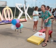 Addison Cassady, marketing freshman, tossing a beanbag at the Chi Omega beanbag toss during the Party at the soccer field on Aug 23rd in the parking lot of the soccer field. Photo by Kayla White.