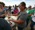 Patty Gilmore serves burgers for the Baptist Student Ministry. Photo by Bradley Wilson