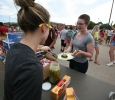 Serah Welborn gets a free hamburger from the Baptist Student Ministry. Photo by Bradley Wilson