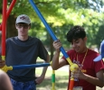 With friends on the orange team, Orlando Espinoza, psychology freshman, builds a structure on the Quad as part of Roundup Olympics while Jared Byrne, radiology freshman, watches. Photo by Izziel Latour