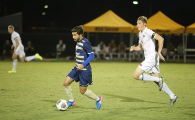 Midfielder Pierre Bocquet, business senior, runs after the ball at the soccer game against St. Edward's. MSU won 1-0. Photo by Bradley Wilson