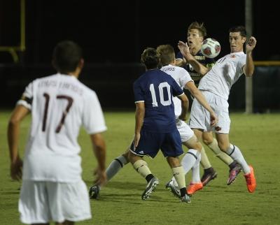 Forward Scott Doney, psychology senior, blocks the ball at the soccer game against St. Edward's. MSU won 1-0. Photo by Bradley Wilson