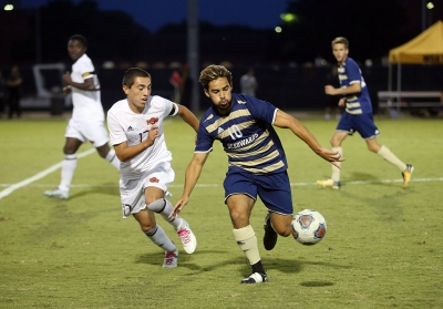 Midfielder Carlos Flores, sports medicine freshman, chases after the ball at the soccer game against St. Edward's. MSU won 1-0. Photo by Bradley Wilson