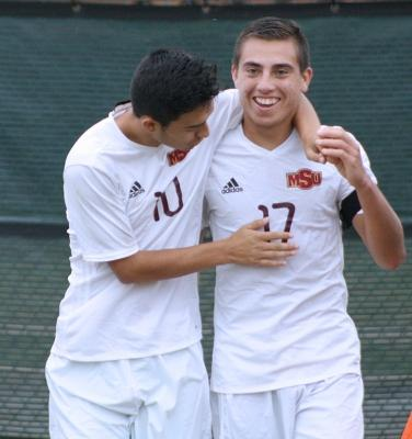 Midfielder and business management sophomore Sebastian Venegas congratulates midfielder and sports medicine feshman Carlos Flores, for scoring a goal, bringing the socre to 3-0 against Colorado Mesa University. Nov 12. Photo by Bridget Reilly