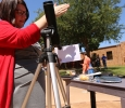 Dean Margaret Brown Marsden shows the eclipse as transmitted through a telescope at the solar eclipse watch party Aug. 21, 2017 on Sunwatcher Plaza at Midwestern State University. Photo by Bradley Wilson