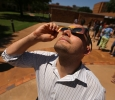 Walter Lambert, business analyst at the Small Business Development Center, watches the eclipse at the solar eclipse watch party Aug. 21, 2017 on Sunwatcher Plaza at Midwestern State University. Photo by Bradley Wilson