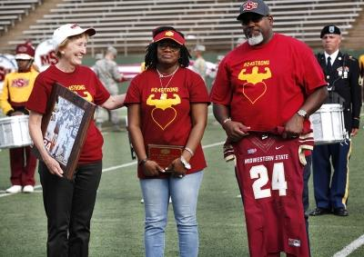 President Shipley, Tammy Grays, and Robert Grays, stand in honor of Robert Grays to retire the number 24 at the Memorial Stadium during the football game against Tarleton State on Nov. 4, 2017. Photo by Harlie David