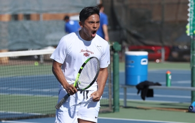 Dillon Pineda, biology junior, yells in exitement after winning his doubles match during the Collin College vs. MSU tennis meet at MSU on Friday, Feb. 9, 2018. Photo by Francisco Martinez