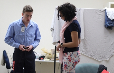 """Sam Mitchell tries on shoes for his costume of """"Bobby"""" at the final fittings on Febraury 16. Photo by: Leo Gonzales"""