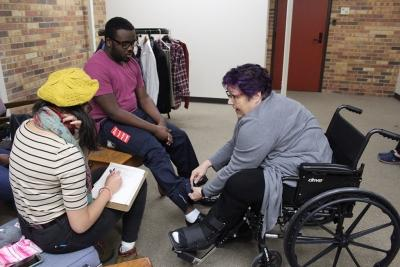 Student worker Kaylor Winter-Roach, and Elizabeth Lewandowski discusing Addrian Gaut's pants for actors on Thursday, Feb 8, 2018. Photo by Leonardo Gonzalez.