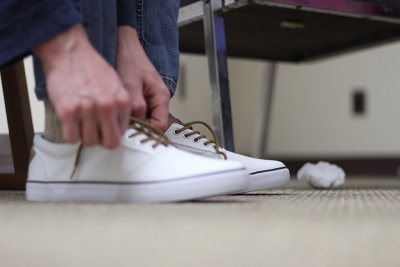 """Sam Mitchell tries on shoes for his costume of """"Bobby"""" at the final fittings on Febraury 14. Photo by: Avery Whaite"""