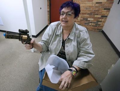 "Theater department chair Elizabeth Lewandowski plays with a prop for ""Urinetown"" Jan. 26. Photo by Bradley Wilson"