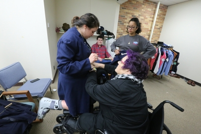 """Elizabeth Lewandowski helps fit costumes with Kaylor Winter-Roach in preparation for """"Urinetown"""" that opens Feb. 22 at Midwestern State University. Photo by Bradley Wilson"""