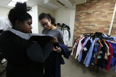 """Kaylor Winter-Roach works with cast members and their costumes in preparation for """"Urinetown"""" that opens Feb. 22 at Midwestern State University. Photo by Bradley Wilson"""