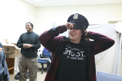 """Ellanor Collins tries on her police officer's hat in preparation for """"Urinetown"""" that opens Feb. 22 at Midwestern State University. Photo by Bradley Wilson"""