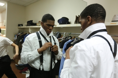 "Kendall Jones puts on his Senator Fipp costume before the first dress rehearsal of ""Urinetown,"" Feb. 18. Photo by Bradley Wilson"