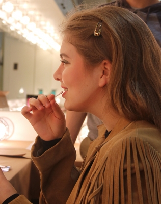 Haley Hancock, music freshman, adds the finishing touches to her character's make-up during the first make-up call held in the dressing room on Friday, Feb.16, 2018. Photo by Joanne Ortega