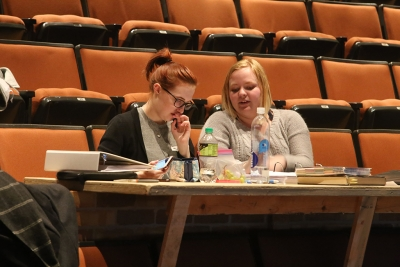 Katie Cagle and Emily Burns at rehearsal for the Midwestern State University production of Urinetown. Photo by Bradley Wilson